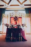 Decor of a wedding restaurant in maroon color with flowers. And details royalty free stock images
