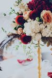 Decor of a wedding restaurant in maroon color with flowers. And details royalty free stock image