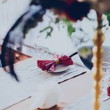 Decor of a wedding restaurant in maroon color with flowers. And details stock photography