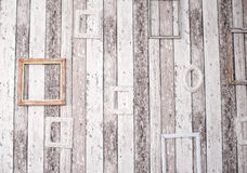 Decor of wooden picture frames on the grunge wall Royalty Free Stock Images