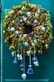 Decor. Wreath on the vintage door. Ceramics stock image