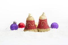 Decoração Bels do Natal com as bolas na neve Fotos de Stock Royalty Free