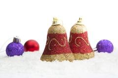 Decoração Bels do Natal com as bolas na neve Fotografia de Stock Royalty Free