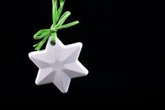 Decoração da árvore de Natal Estrela no preto Fotos de Stock Royalty Free