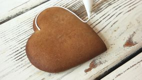 Decoração da cookie do pão-de-espécie com açúcar de crosta de gelo filme