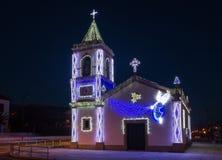Decoração das luzes da igreja do Natal imagem de stock