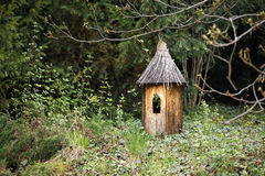 Decoração de madeira na forma da casa pequena Fotografia de Stock