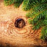 Decoração do feriado de inverno do Natal no fundo de madeira com co Foto de Stock