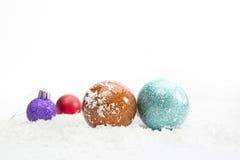 Decoração do Natal com as bolas na neve Imagem de Stock Royalty Free