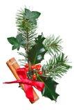 Decoração do Natal com canela e curva do azevinho. Foto de Stock Royalty Free