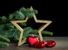 Decoração do Natal com estrela de madeira Fotos de Stock Royalty Free