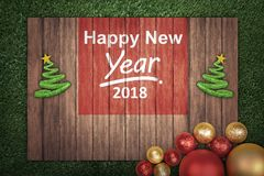 Decoração do Natal com mensagem do ano novo feliz 2018 na madeira Fotos de Stock Royalty Free