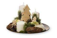 Decoração do Natal - composição do Natal feita das velas e dos acessórios decorativos do Natal isolados Fotos de Stock