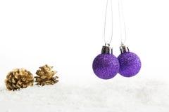 Decoração do Natal dois com as bolas na neve Fotografia de Stock Royalty Free