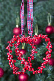 Decoração do Natal - dois corações vermelhos Fotografia de Stock Royalty Free