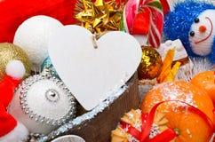 Decoração do Natal, galho do pinho, cartão para o texto, quinquilharia do Natal Imagens de Stock Royalty Free