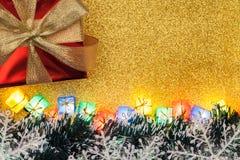Decoração do Natal no fundo do ouro Fotos de Stock Royalty Free
