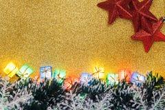 Decoração do Natal no fundo do ouro Imagem de Stock Royalty Free