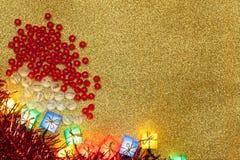Decoração do Natal no fundo do ouro Imagens de Stock Royalty Free