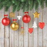 Decoração do Natal que pendura, no fundo de madeira das pranchas do vintage Imagem de Stock