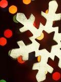 Decoração do Natal sob a forma de um floco de neve de madeira Foto de Stock
