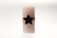 Decoração do Natal Vela com uma corda e uma estrela Fotografia de Stock Royalty Free