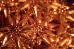 Decoração dourada do Natal dos cones do pinho fotografia de stock royalty free