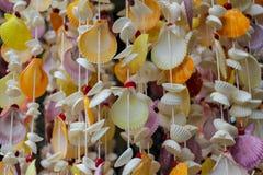 Decoração feita de shell coloridos do mar Fotografia de Stock Royalty Free