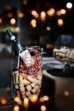 Decoração festiva com uma garrafa do vinho Foto de Stock Royalty Free