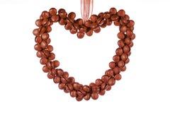 Decoração vermelha da beira do coração contra o fundo branco Foto de Stock Royalty Free