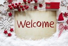 Decoração vermelha do Natal, neve, boa vinda inglesa do texto foto de stock royalty free