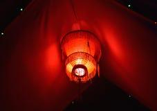 A decoração vermelha ilumina a fotografia do fundo Fotografia de Stock