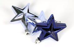 Decorações da estrela azul para a árvore de Natal imagens de stock
