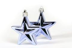 Decorações da estrela azul para a árvore de Natal fotografia de stock