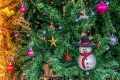 Decorações do Natal, boneco de neve na árvore de Natal Imagem de Stock Royalty Free