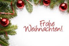 Decorações do Natal com o cumprimento do Natal no ` alemão Frohe Weihnachten! ` Imagem de Stock