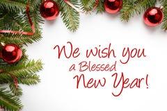 Decorações do Natal com o ` do cumprimento nós desejamos-lhe um ano novo abençoado! ` Foto de Stock Royalty Free