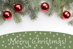 Decorações do Natal com o Feliz Natal do ` do cumprimento! ` Fotos de Stock Royalty Free
