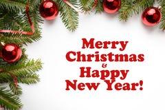 Decorações do Natal com o Feliz Natal do ` do cumprimento e o ano novo feliz! ` Imagens de Stock