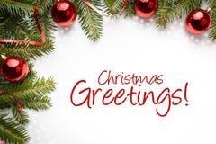 Decorações do Natal com os cumprimentos do Natal do ` do cumprimento! ` Foto de Stock