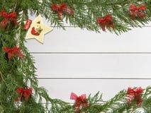 Decorações do Natal no fundo branco de madeira Imagens de Stock Royalty Free