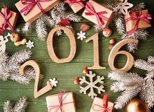 Decorações do Natal ou do ano novo na tabela para 2016 Fotografia de Stock Royalty Free
