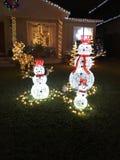 Decorações do Natal que iluminam o boneco de neve Fotografia de Stock