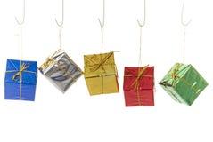 Decorações minúsculas do presente de Natal Fotografia de Stock Royalty Free