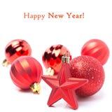 Decorações vermelhas do Natal - a estrela e as bolas, isoladas Foto de Stock