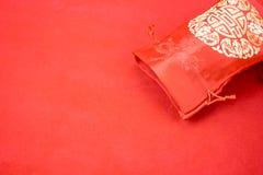 Decoración china del Año Nuevo: el rojo sentía el paquete o al prisionero de guerra w de la tela del ANG Imagen de archivo