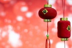 Decoración china del Año Nuevo en un bokeh rojo del fondo con el lomo Fotografía de archivo libre de regalías