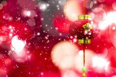 Decoración china del Año Nuevo en un bokeh rojo del fondo con el lomo Fotografía de archivo