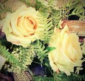 Decoración con las rosas y el efecto del vintage Imágenes de archivo libres de regalías