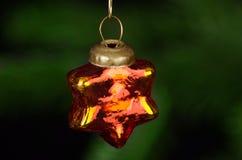 Decoración de cristal roja del árbol de navidad de la estrella Imagen de archivo